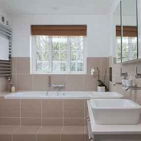 cream and white bathroom with 2 sinks