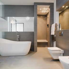 modern looking bathroom with large free standing bath and large mirrors