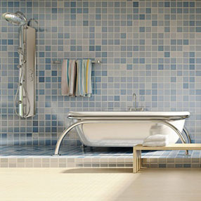 Blue tiled bathroom with silver bath and shower