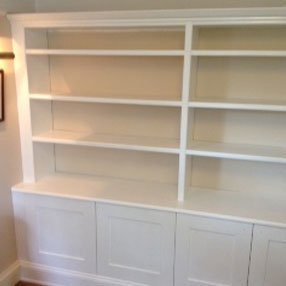 White shelving unit and cupboard