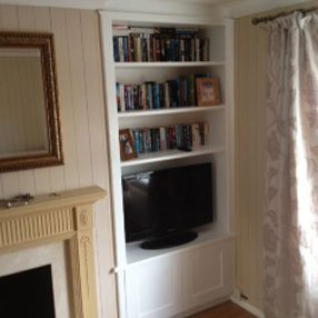 Fitted white shelving unit and cupboard