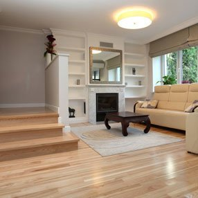 lower living room with wooden floor and corner sofa