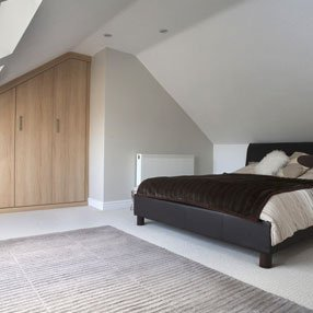 Attic conversion into bedroom with built in wardrobes