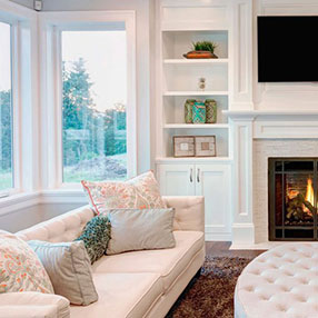 White extension room with all white furniture and white walls